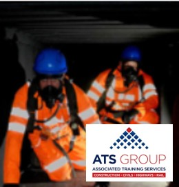 Workers underground in a tunnel wearing hi vis vests and helmet