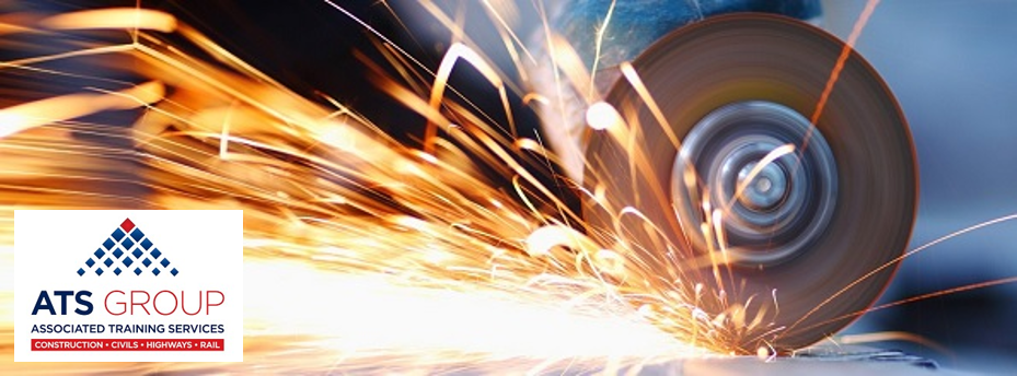 A grinder cutting metal with sparks flying
